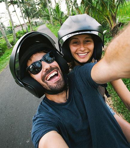Couple taking selfie on bike