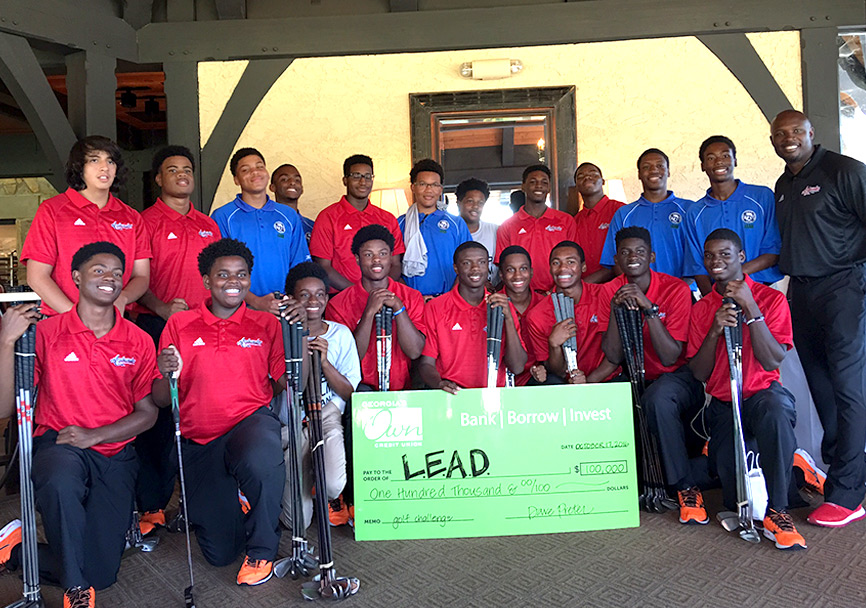 LEAD Ambassadors accepting donation check