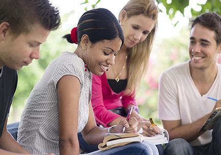 group of friends doing homework