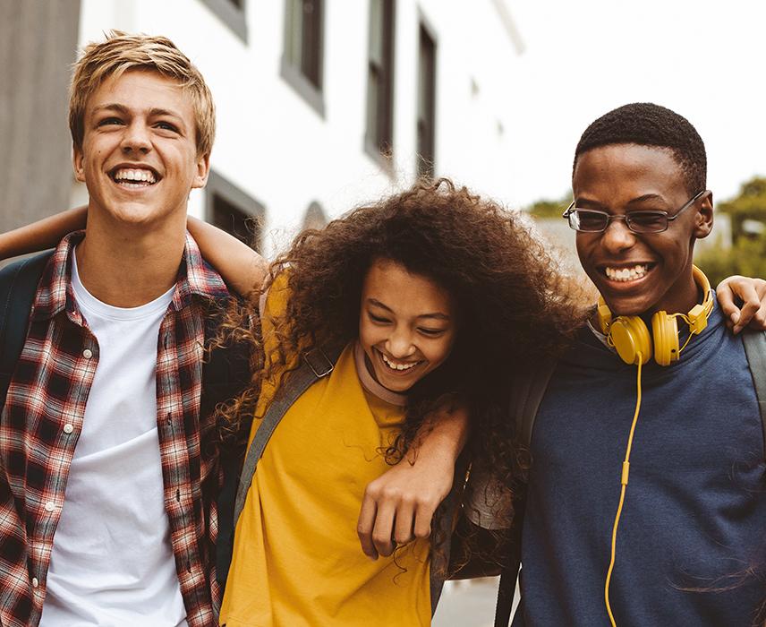 three teenagers laughing